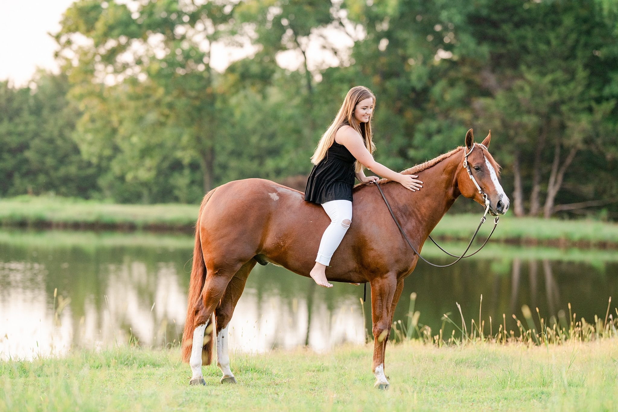 https://kirstiemarie.com/wp-content/uploads/2020/09/Sydnie-Ochs-and-No-Doubting-Me-AQHYA-World-Champion-Western-Pleasure-Senior-Pictures-Kirstie-Marie-Photography_0016-2048x1365.jpg